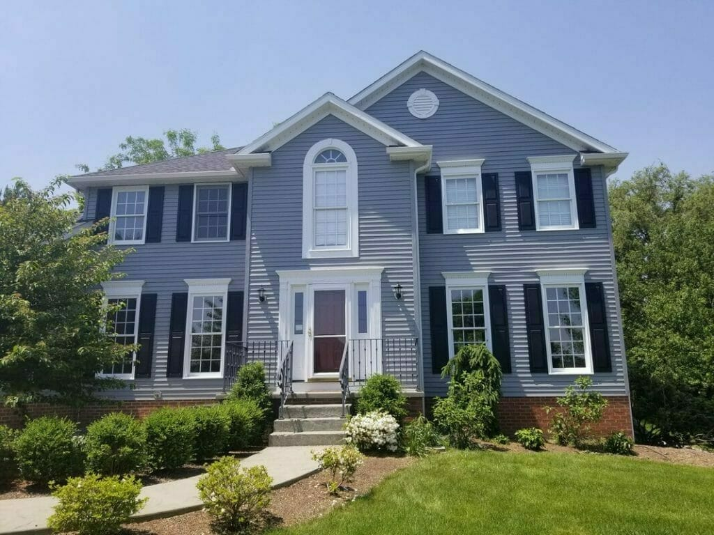 Front view of blue house and yard   Exterior painters ohio